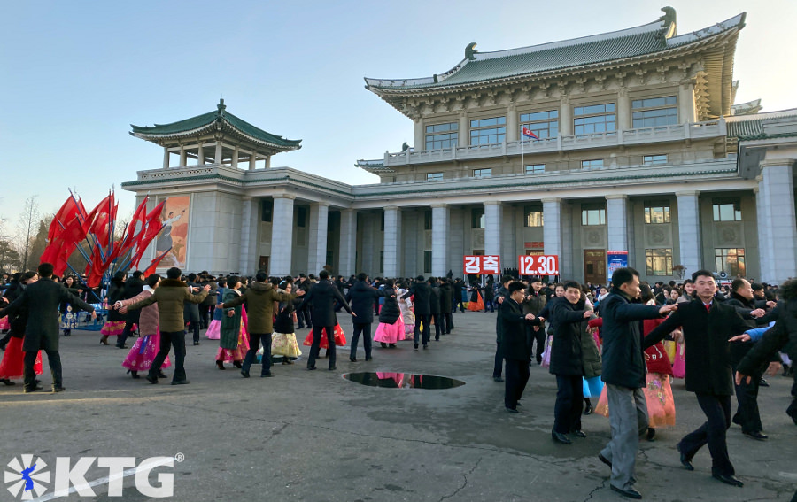 Mass dances outside the Pyongyang Grand Theatre in North Korea, DPRK. Trip arranged by KTG Tours.