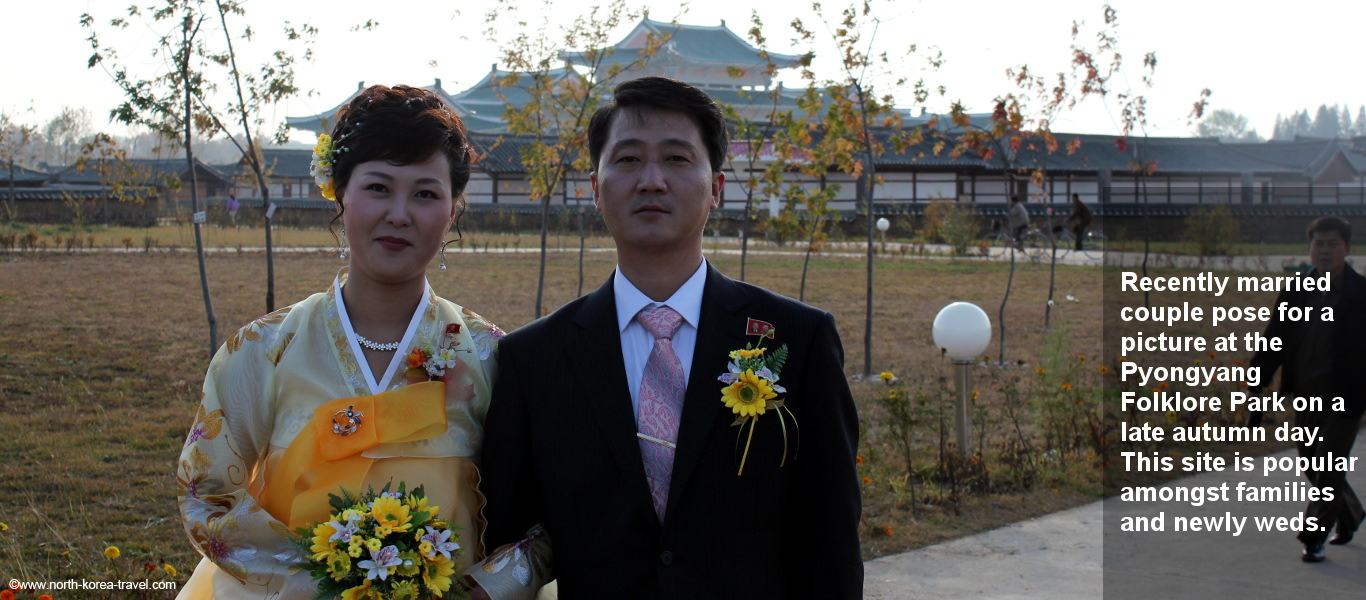 Recently married couple in North Korea. This picture was taken in the Pyongyang Folkloric park also known as mini-Pyongyang Folk Park