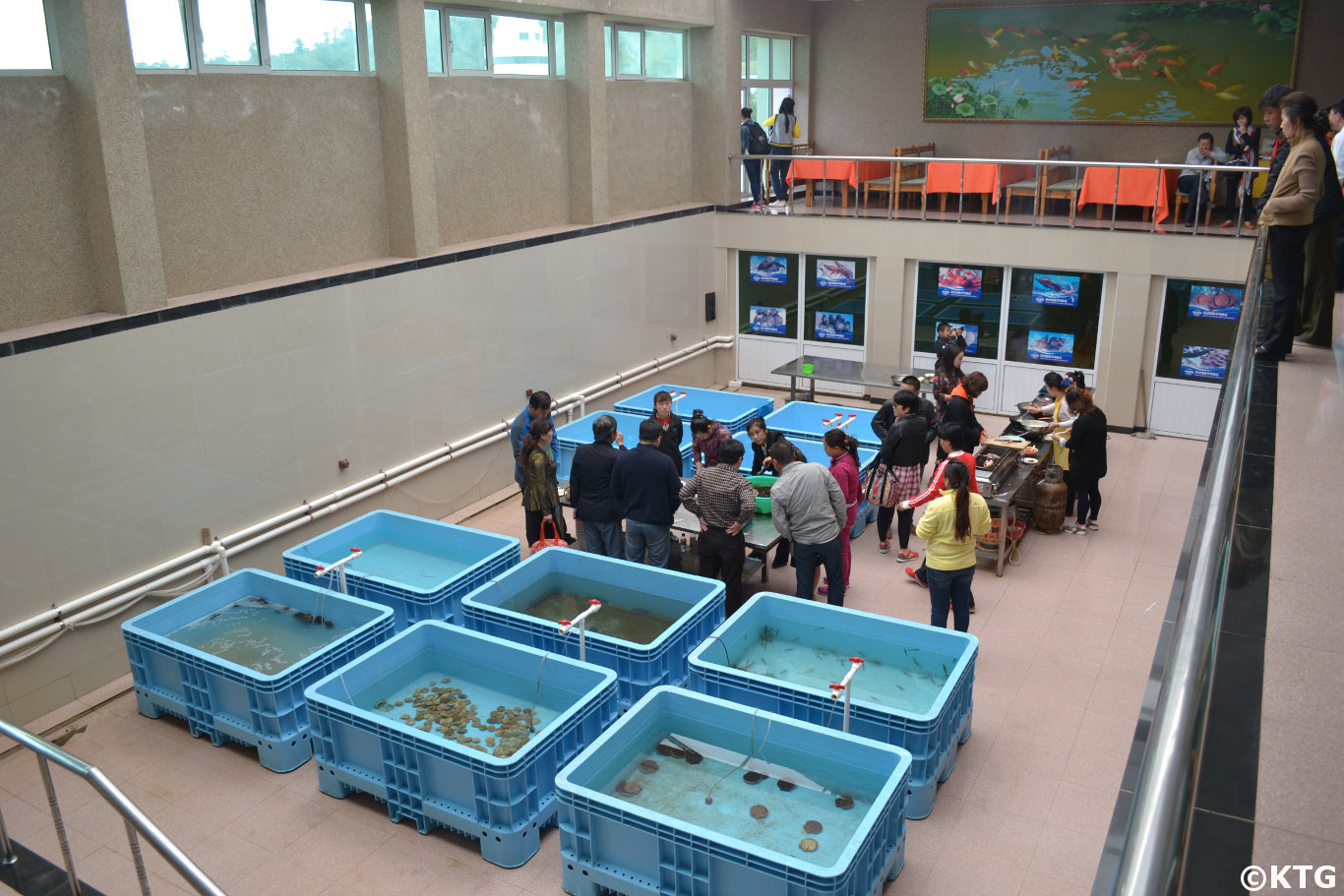 Travellers picking their food at the Taehung Rason Corporation in Rajin, DPRK (North Korea). KTG Tours