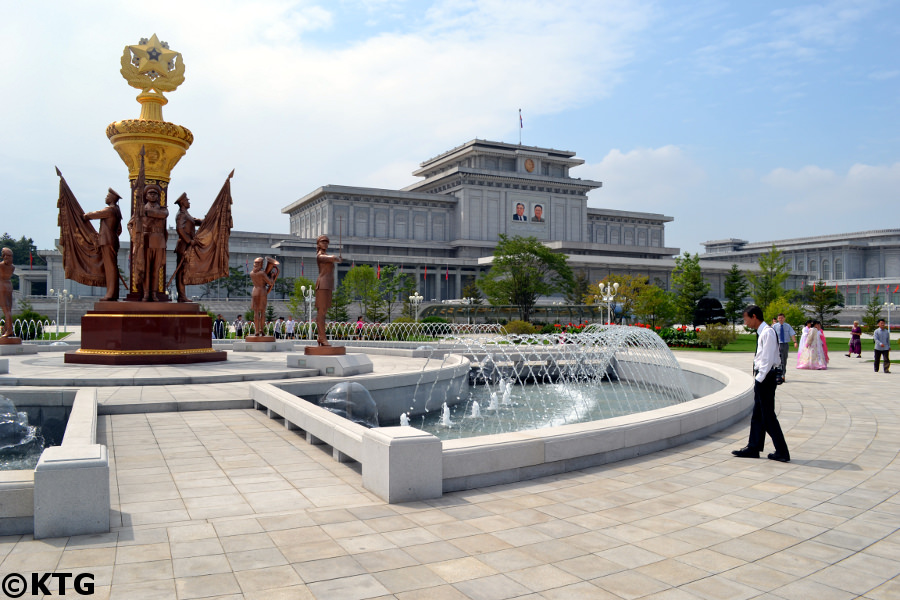 Travellers at the fountain outside the Kumsusan Palace of the Sun in Pyongyang, North Korea, DPRK. It used to be called the Kumsusan Memorial Palace and the Kumsusan Assembly Hall Trip arranged by KTG Tours