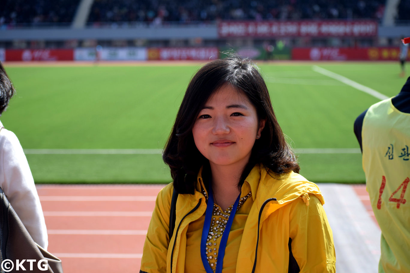 One of the best tours guides in North Korea, Kim Sung Mi, was in charge of coordinating the project of rebuilding a courtyard at the Kaesong Folk Hotel. We took the picture at Kim Il Sung stadium during the Pyongyang Marathon
