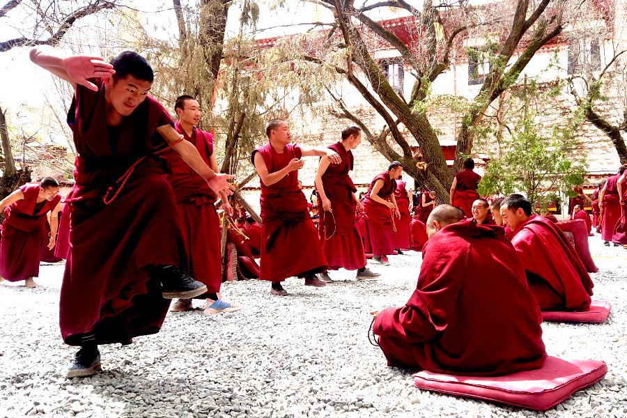 Tibetan monks debating at the Sera Monastery in Lhasa Tibet China