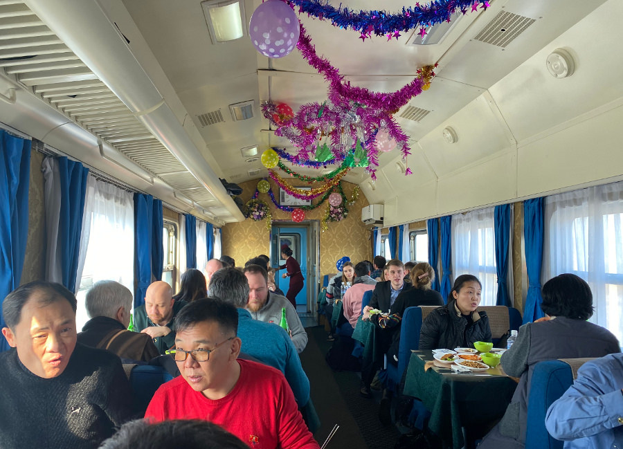 Restaurant carriage on the train from Pyongyang in North Korea to China. The decorations are because of New Year's. Trip arranged by KTG