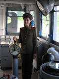 Local North Korean female guide in the USS Pueblo spyship in Pyongyang, North Korea