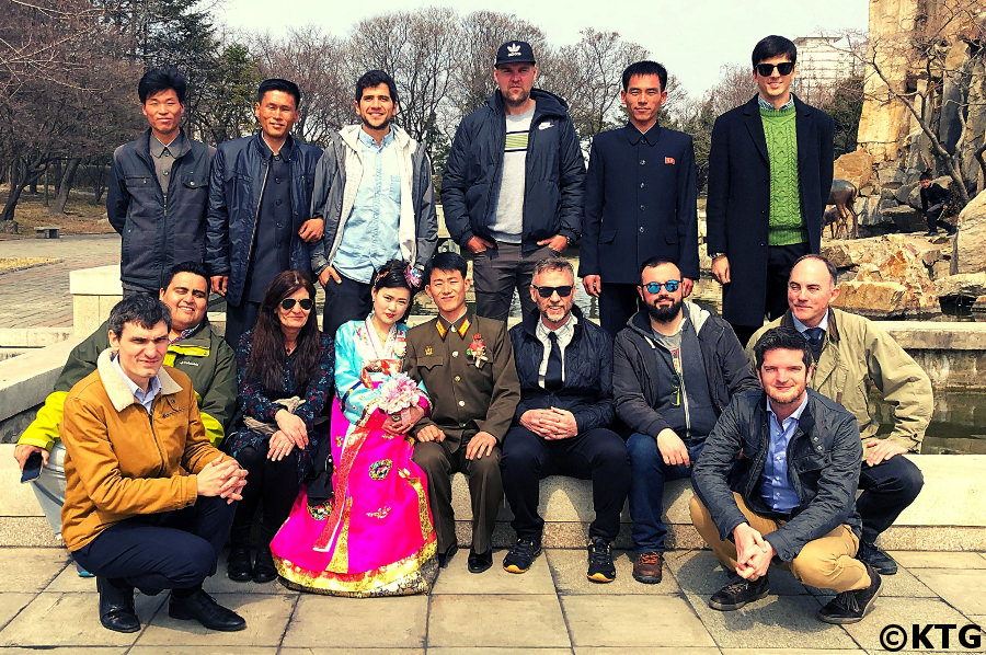 KTG group tour taking a picture in Pyongyang capital of North Korea with a recently married couple and their friends