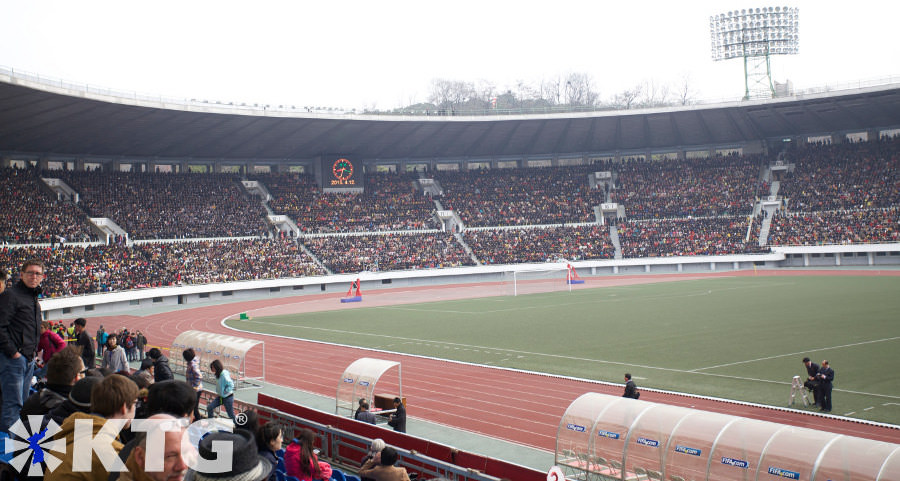 Foreigners at Kim Il Sung Stadium full with 40,000 Koreans during the Pyongyang Marathon, DPRK. Picture taken by KTG Tours