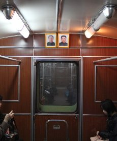 Portraits of the Leaders Kim Il Sung and Kim Jong Il in of the carriages in the Pyongyang Metro.