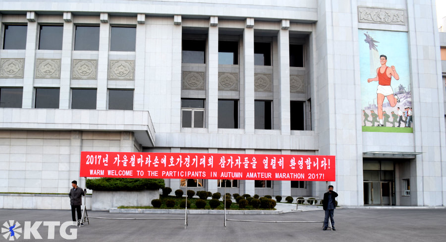 Welcoming banner of the first ever Pyongyang Autumn Marathon, North Korea. This is just outside Kim Il Sung Stadium