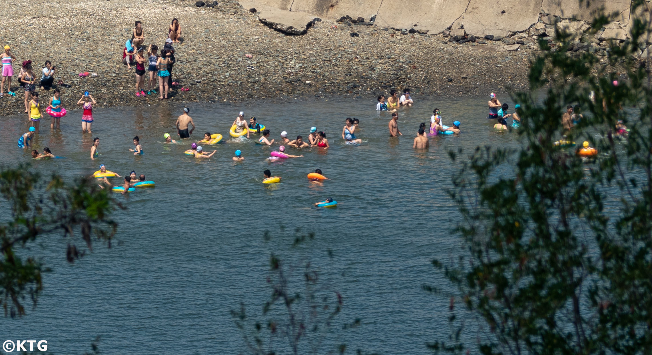 North Koreans swimming in the sea and enjoying a day at the beach in Nampo city. Picture taken by KTG tours