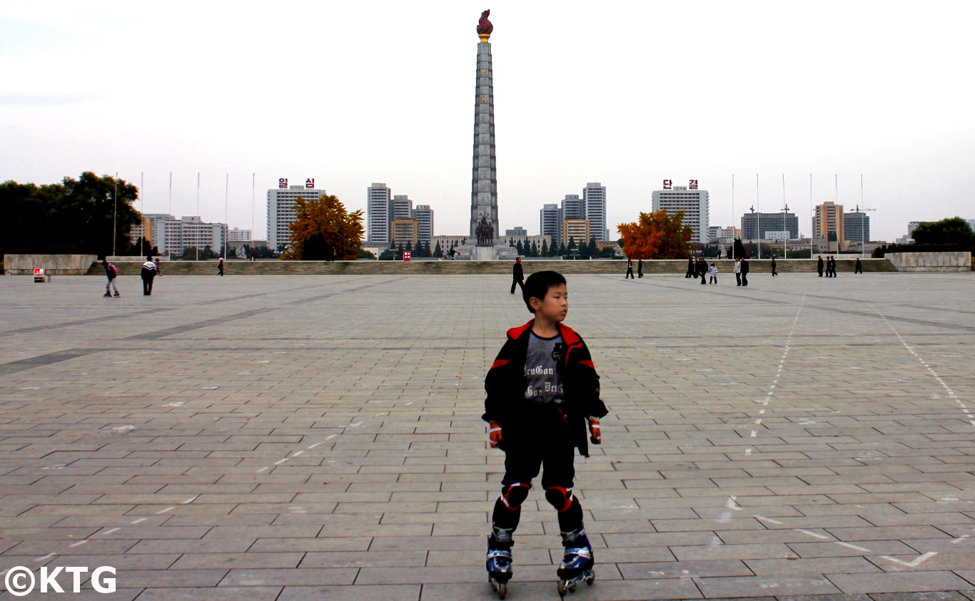 Child roller skating in Kim Il Sung Square, the heart of Pyongyang capital of North Korea (DPRK). Join KTG Tours to discover Kim Il Sung Square!