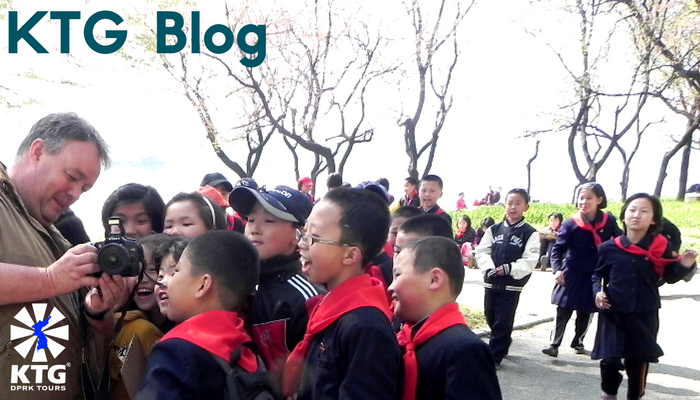 Children in Pyongyang, North Korea with a KTG tourist