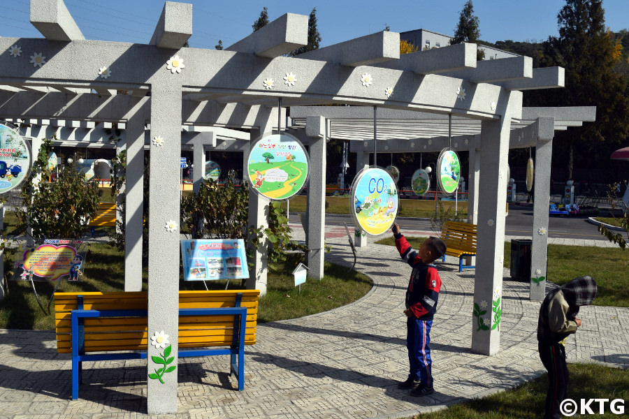 Sign explaining to kids the consequences of CO2 emissions at the Pyongyang Children's Traffic Park, North Korea (DPRK)