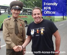 DPRK soldier shaking hands with a traveller in the DMZ, DPRK
