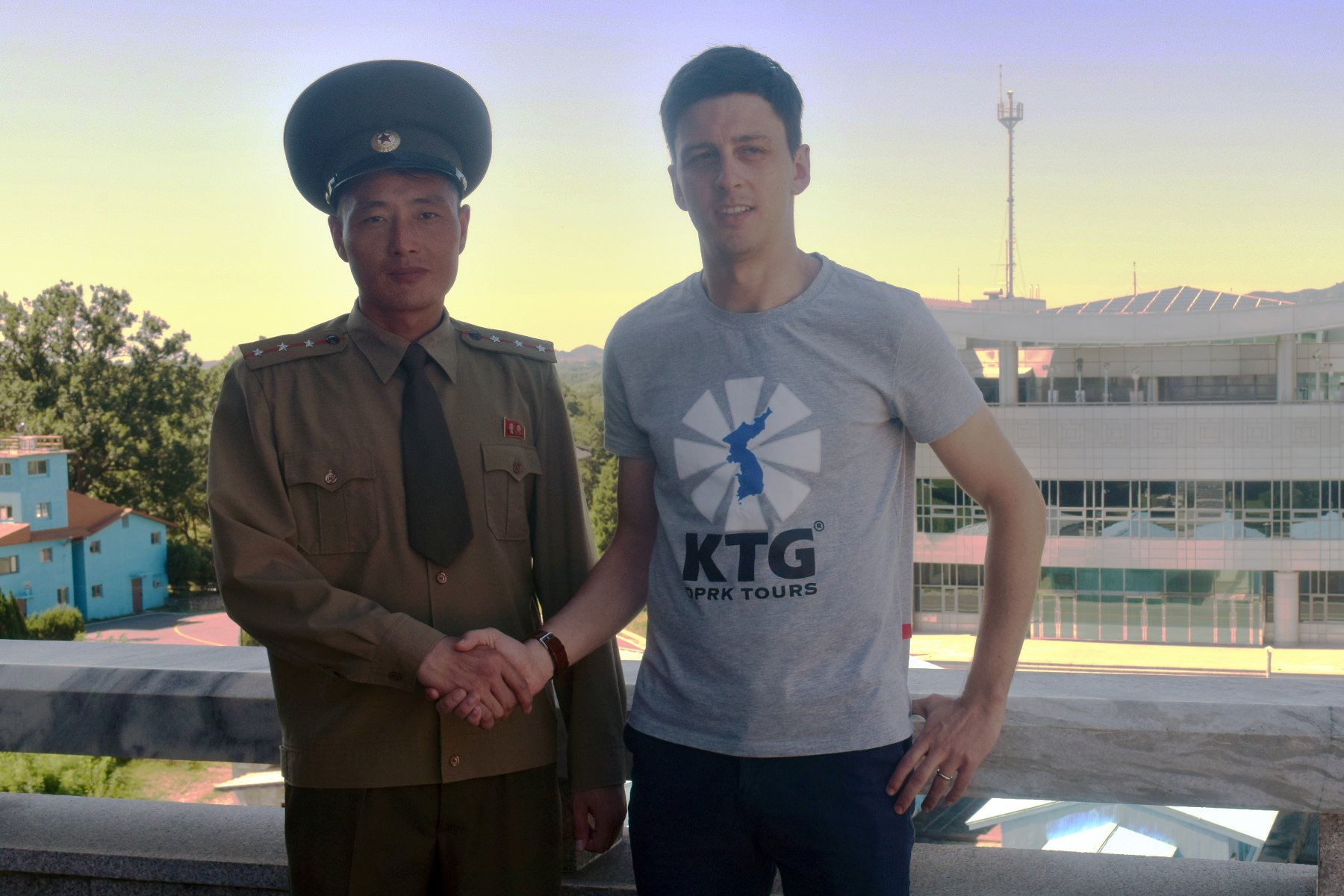 KTG tour leader with North Korean soldier at the DMZ or Panmunjom in North Korea, the DPRK
