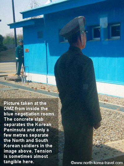 North Korean and South Korean soldiers separated only by a few metres. Picture taken at the DMZ in from the North Korean side of the 38th Parallel
