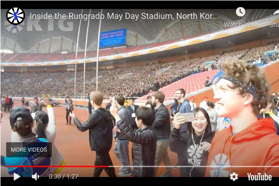 KTG Tours tour guide entering the Rungrado May Day Stadium in Pyongyang, North Korea (DPRK) with 90,000 locals cheering us on!