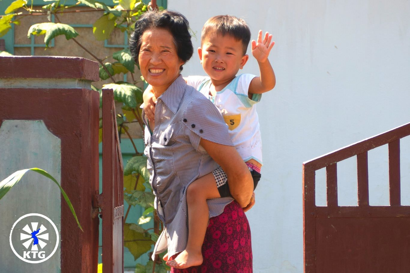 Grandmother and grandson in a cooperative farm near Nampo city in North Korea. Trip arranged by KTG Tours