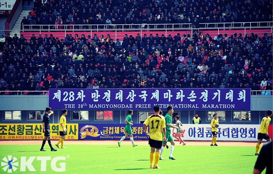 Football match at Kim Il Sung Stadium in Pyongyang held during the Mangyongdae Prize International Marathon i.e. the Pyongyang Marathon in North Korea. Join the marathon with KTG Tours!