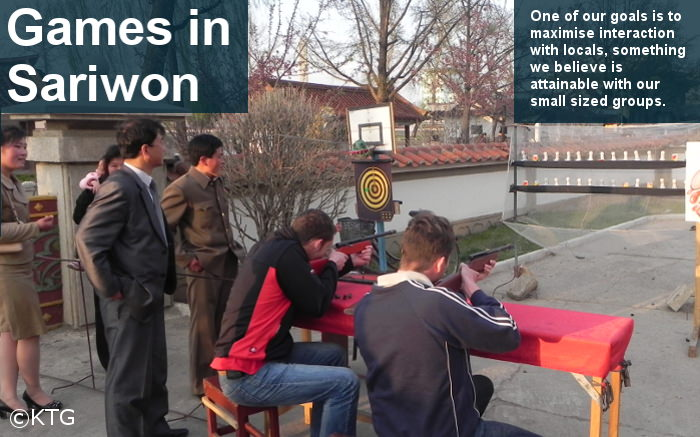 KTG travellers playing a shooting game with North Koreans in the city of Sariwon, capital of North Hwanghae Province, DPRK