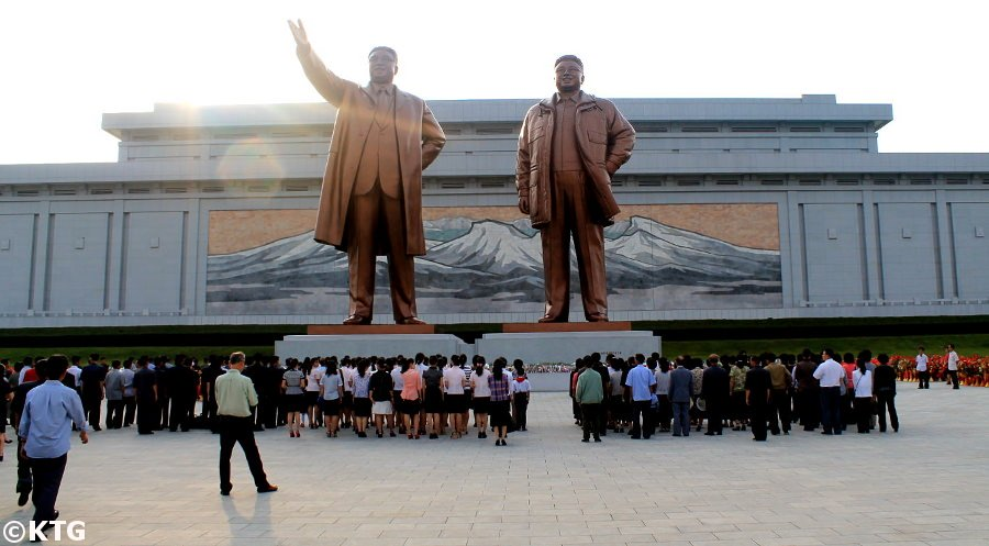 Mansudae Grand Monuments in Pyongang capital of North Korea, DPRK, with KTG Tours. These giant bronze statues of the Leader Kim Il Sung and Kim Jong Il are visited by locals regularly