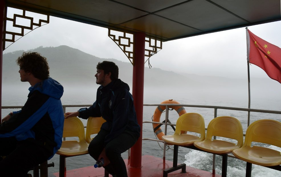 KTG tour leader Tim and traveller Zac at on boat take at Hekou, near Dandong, close to North Korea (DPRK)