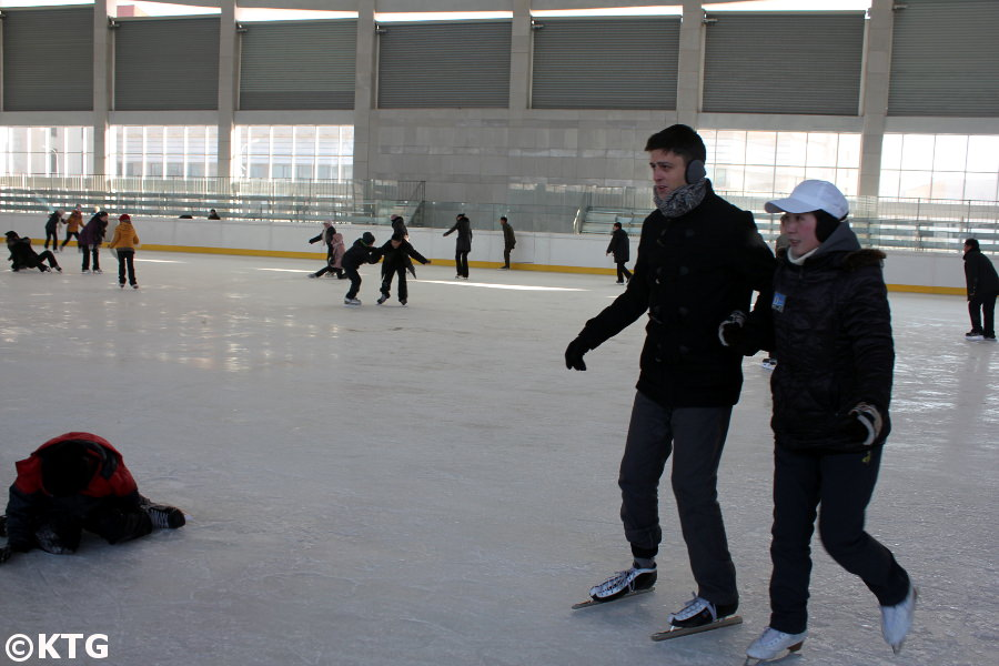 KTG tours staff member trying to learn to ice-skate in Pyonygang, North Korea, DPRK