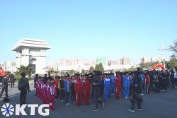 North Korean athletes lining outside Kim Il Sung Stadium for the first ever Autumn Pyongyang Marathon in North Korea