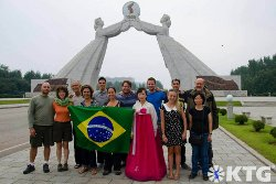 KTG travellers from Brazil at the arch of reunification in Pyongyang, North Korea (DPRK)