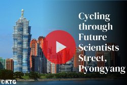 Cycling through Mirae street in Pyongyang with KTG Tours