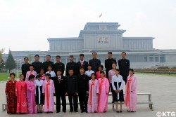 North Koreans taking a group picture at the Kumsusan Palace of the Sun in Pyongyang, North Korea, DPRK. Tour arranged by KTG