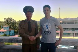 North Korean soldier at the DMZ shaking hands with KTG Tours staff member