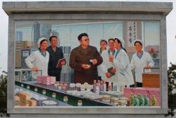 Image du leader Kim Jong Il dans une usine de cosmétiques à Sinuiju en Corée du Nord