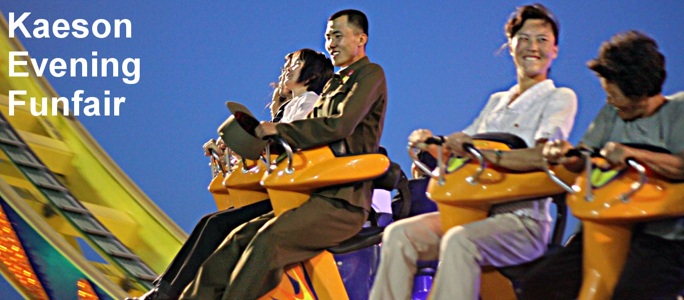 North Korean soldier enjoys a ride at the Kaeson Amusement Park in Pyongyang, North Korea