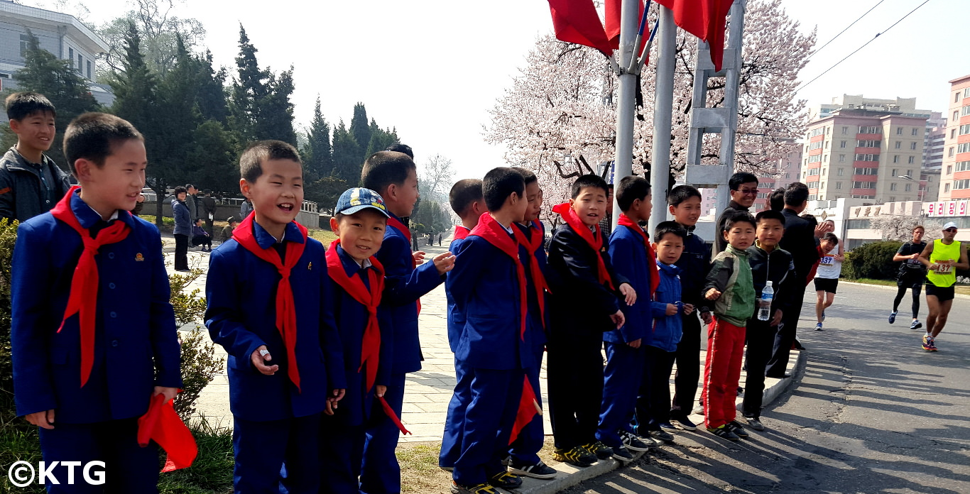 Children supporting runners at the Pyongyang Marathon