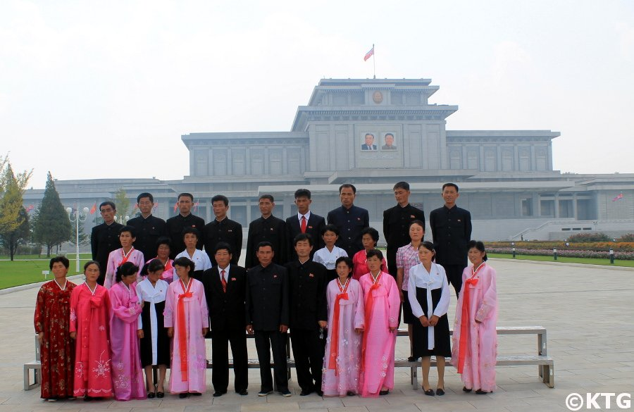 Group of North Koreans posing for a picture at the Kumsusan Palace of the Sun in Pyongyang, North Korea (DPRK). Picture taken by KTG