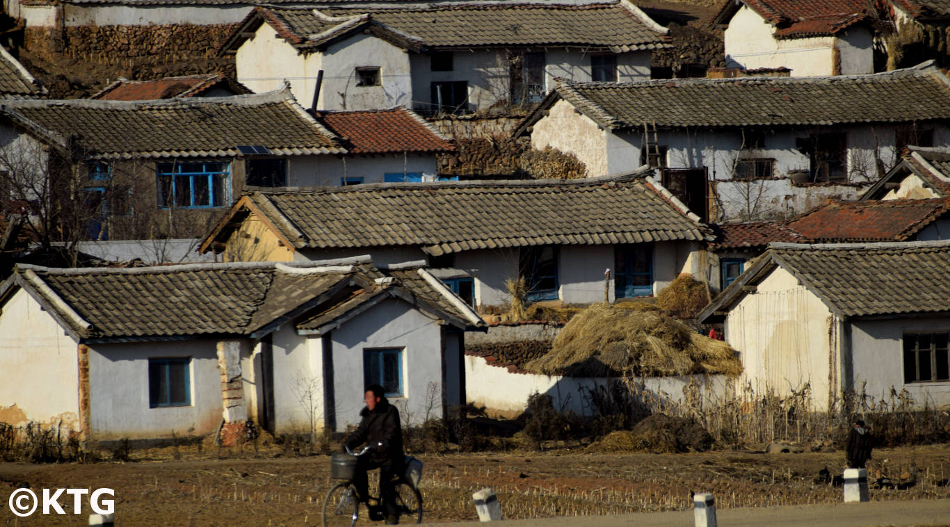Man riding a bike in the countryside in North Korea (Democratic People's Republic of Korea). Tour arranged by KTG Travel