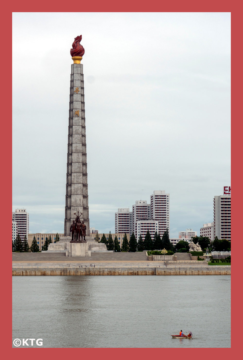 Couple rowing a boat on the Taedong River by the Juche Tower in Pyongyang capital of North Korea. DPRK Trip arranged by KTG Tours