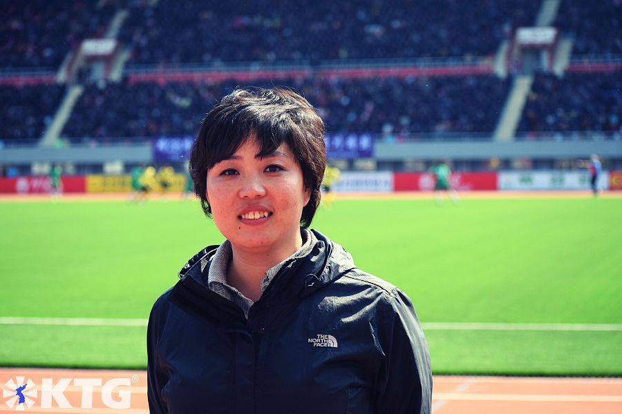 North Korean guide Miss Yu at Kim Il Sung Stadium during the Pyongyang marathon. North Korea picture taken by KTG Tours