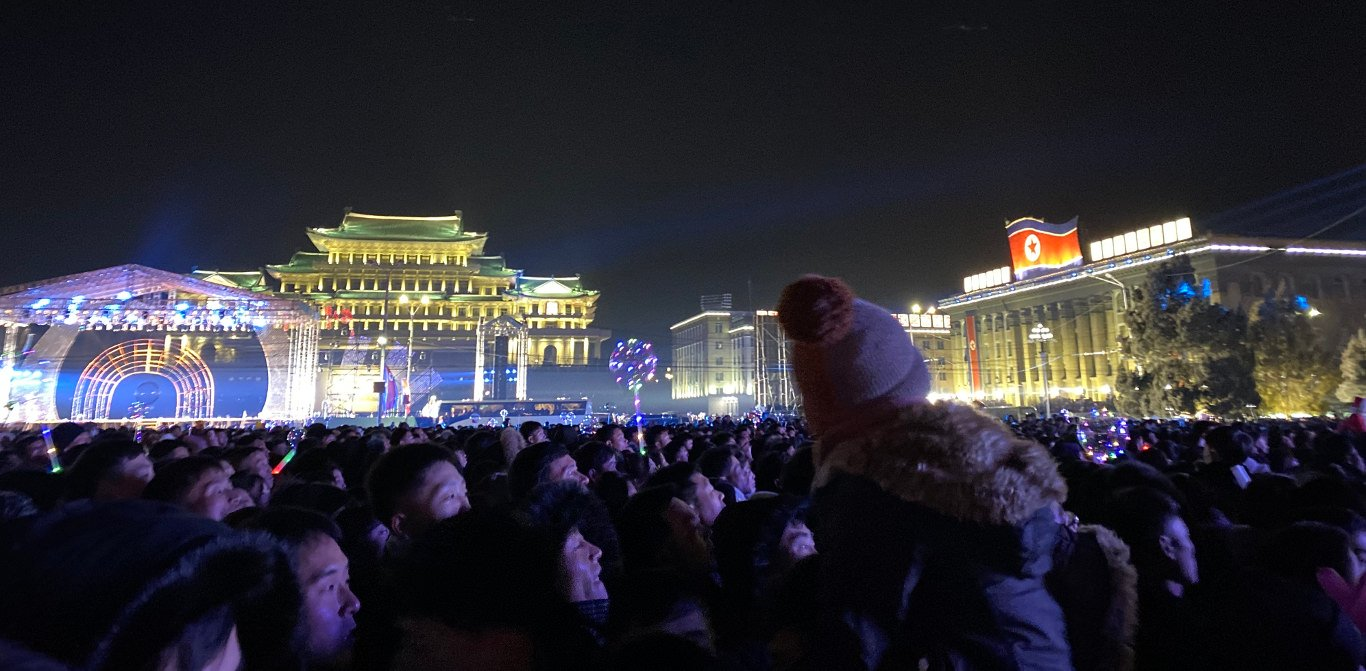 New Year's Even in North Korea. Crowds gathering at Kim Il Sung Square. Trip arranged by KTG Tours