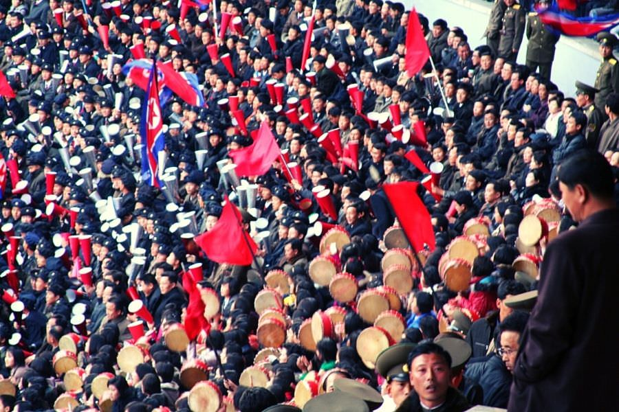 North Korean football fans supporting the DPRK in a match against Japan at Kim Il Sung Stadium in Pyongyang capital of North Korea. Football trip arranged by KTG Tours