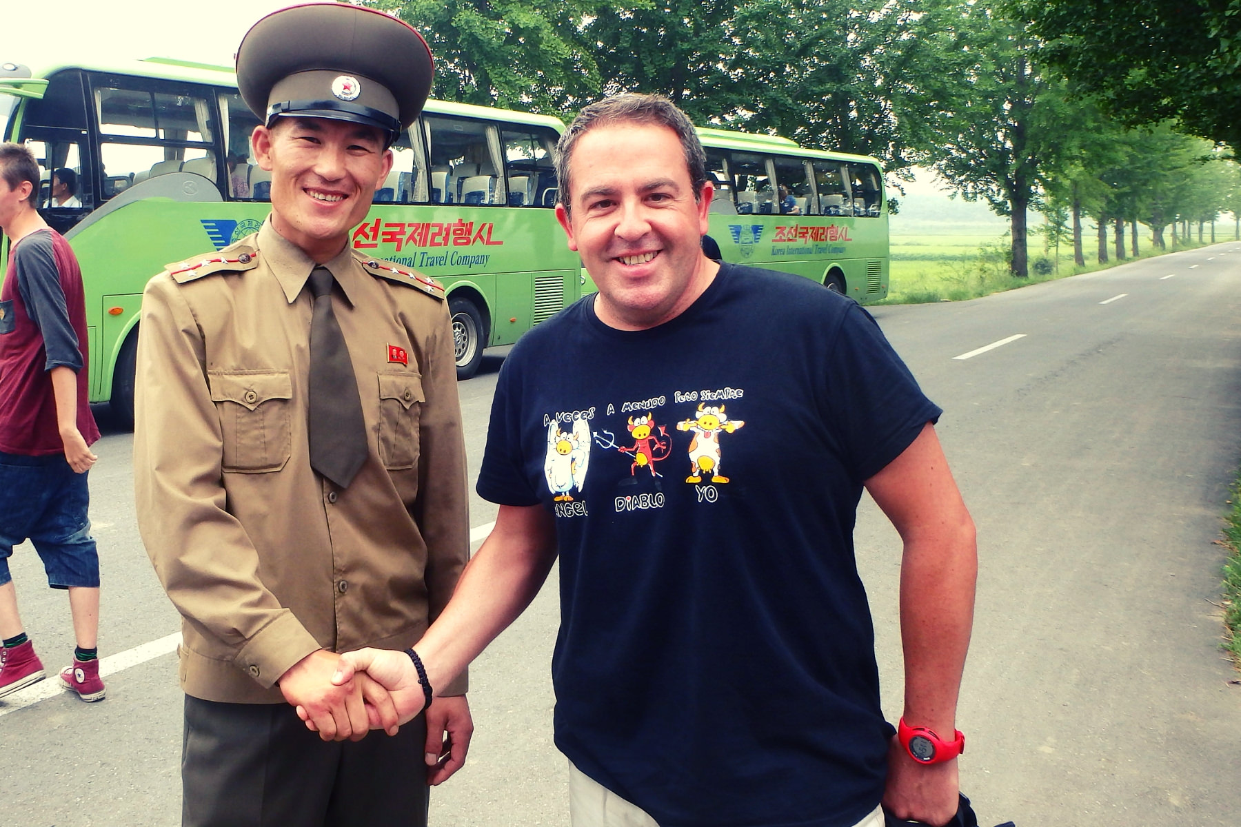 Friendly North Korean soldier shaking hands at the DMZ with a KTG traveller