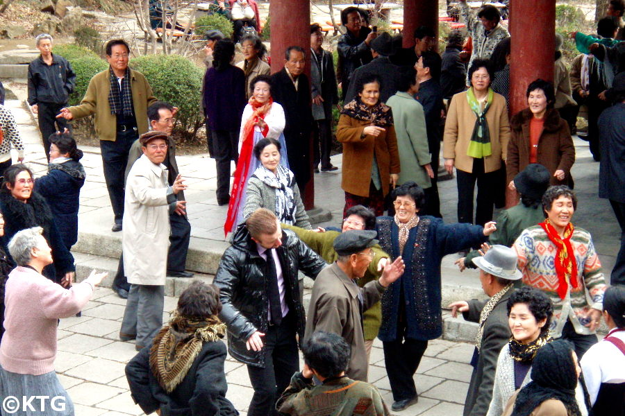 North Koreans dancing with Westerner
