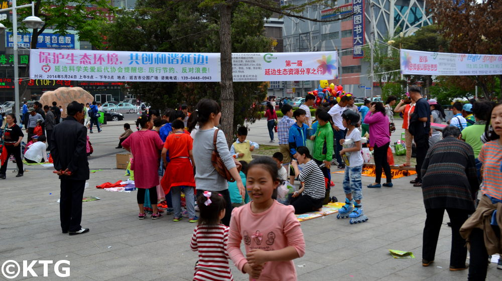 Jumble sale in People's Park in Yanji, the capital of Yanbian, the Korean Autonomous Region in China. Children sell and buy used goods here on some weekends in the spring, summer and early autumn before the cold winter settles in