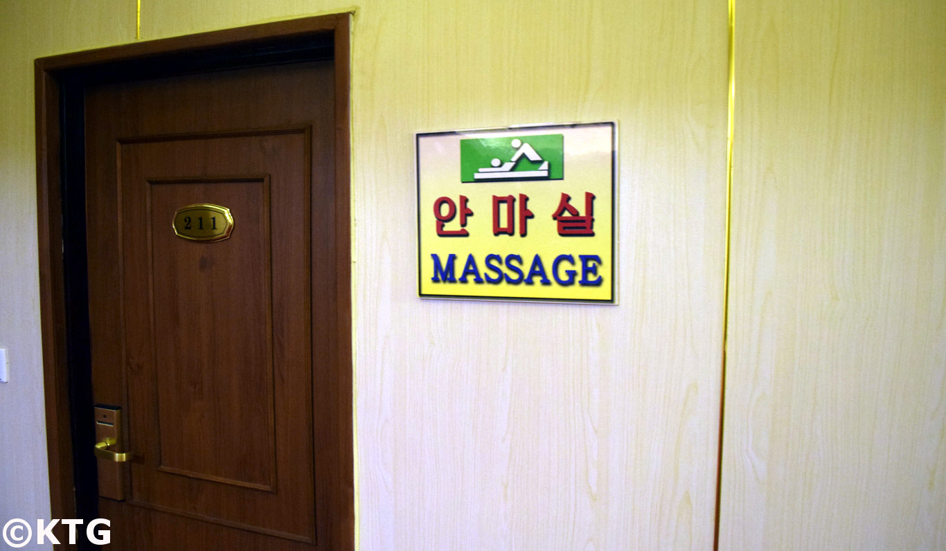 Sign in English and in Korean outside the massage room at the Pyongyang Hotel in North Korea, DPRK