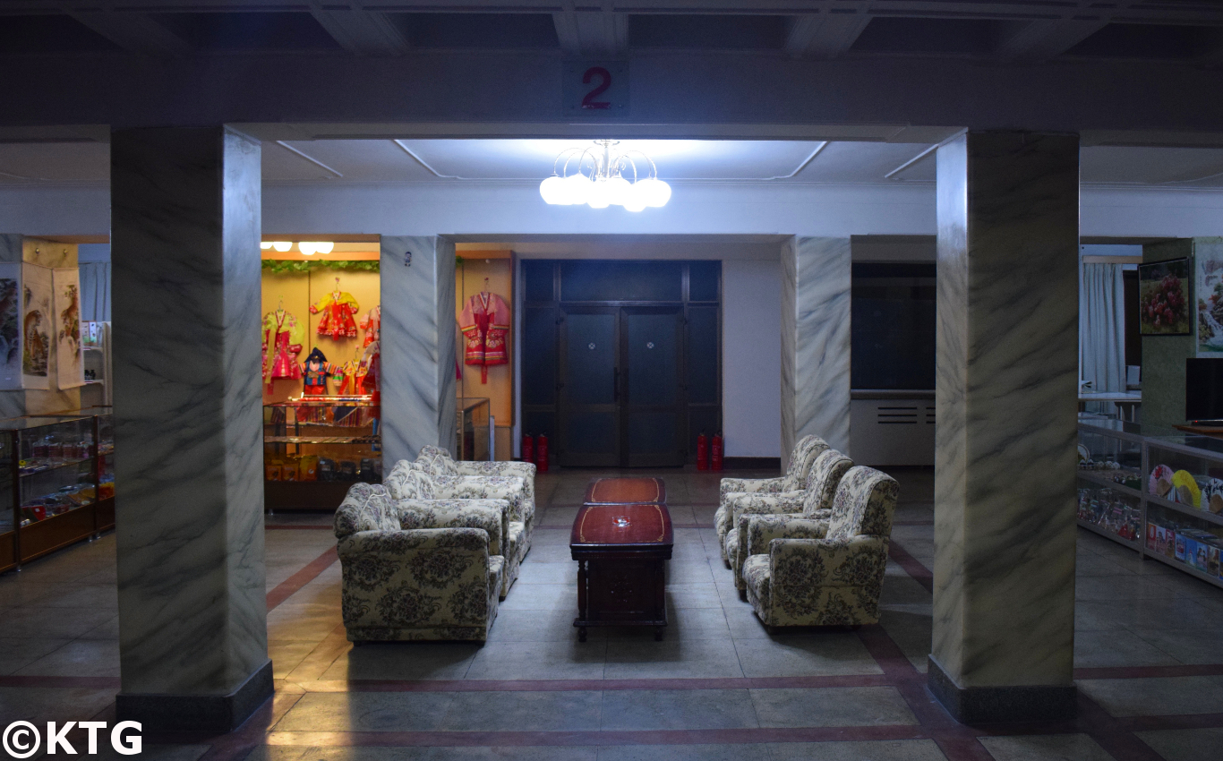 Retro sofas by the souvenir shop and bookstore at the Pyongyang Hotel, a second class economy hotel in North Korea