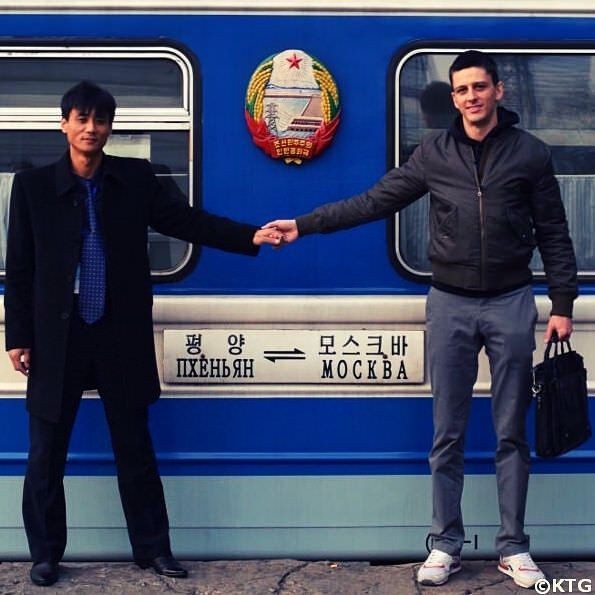 KTG staff member and North Korean guide by the train that goes from Pyongyang to Moscow