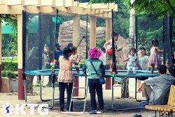 children playing at Pyongyang zoo, North Korea, DPRK