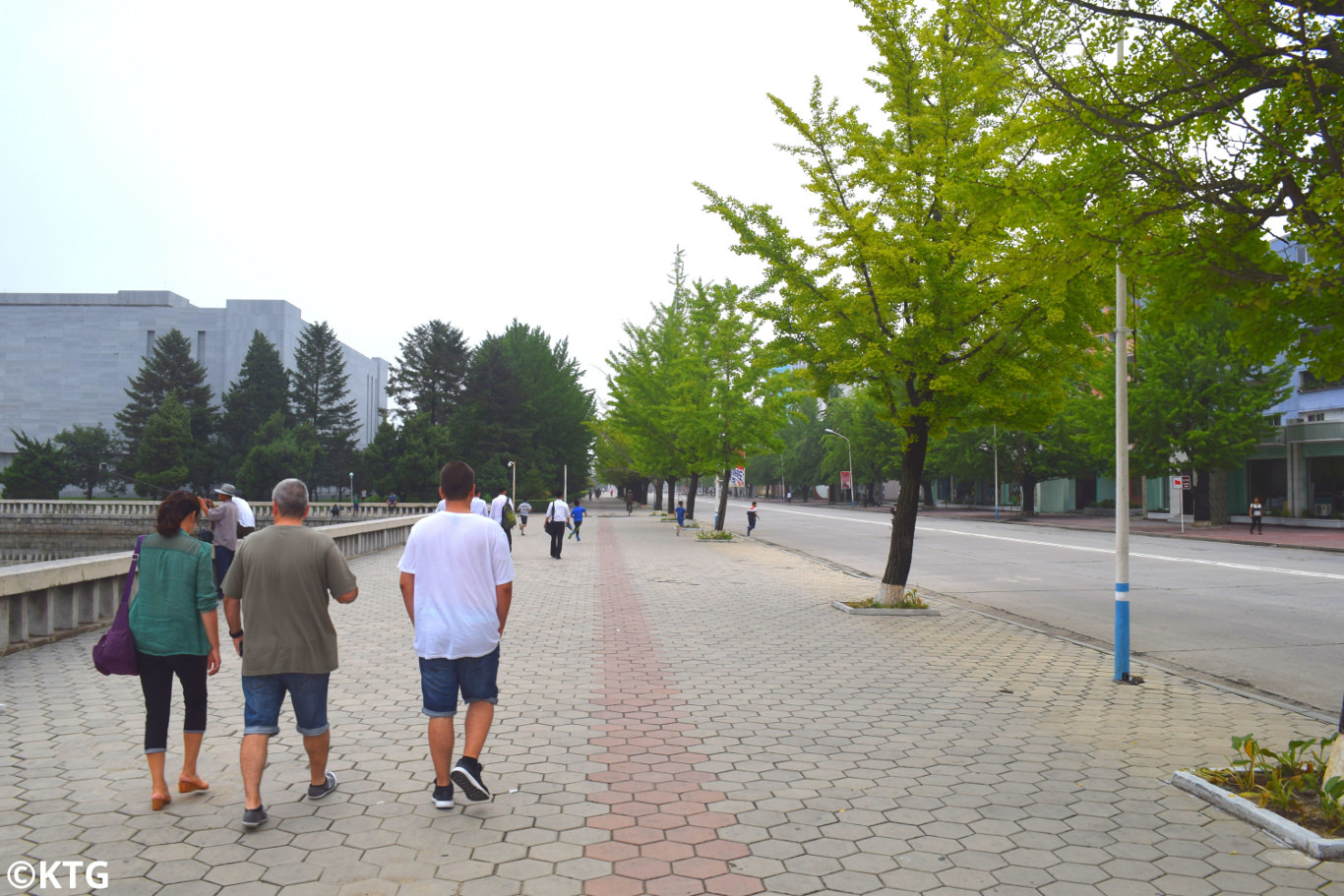 KTG travellers going for a walk outside the Songdowon Hotel in Wonsan city, Kangwon province, North Korea (DPRK). Trip arranged by KTG Tours
