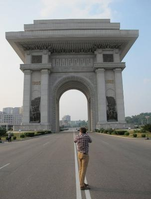 Taking a picture in the middle of the highway of the Arch of Triumph