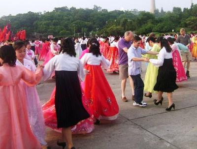 Dancing with locals on our first day in Pyongyang